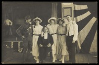 view Servicemen performing a play, in front of the stage. Photographic postcard. 191-.