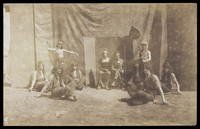 view British servicemen in drag playing characters in a play. Photograph, ca. 1918.