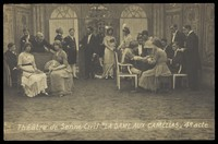 """view French or Belgian prisoners of war, some in drag, posing on stage during a crowded scene of """"La dame aux camélias""""; at Sennelager prisoner of war camp in Germany. Photographic postcard, 191-."""