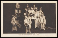 "view British prisoners of war, one in drag, posing for ""The Timbertown Follies"", at a prisoner of war camp in Groningen. Process print, 191-."