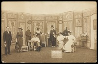 view Prisoners of war, some in drag, posing on stage in 'Miquette et sa mere' at Sennelager prisoner of war camp in Germany. Photographic postcard, 191-.