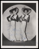 """view Alan Haynes and Terry Gardener performing in drag in their revue 'Why go to Paris"""". Photograph, 1950."""