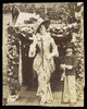 Douglas Byng in drag with a small boy dressed as a man. Photograph, 1911.