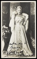 view Douglas Byng in drag during a pantomime. Photograph, 1952.