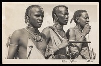 view Three men of the Masai tribe. Photographic postcard by S. Skulina, 195-.