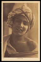 """view """"Mohamed"""" wearing patterned garments. Process print, 192-."""