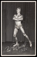 view Red McCarthy, the Olympic ice skater and later stunt skater, posing as a silver ice-skating statue. Photographic postcard, 1936.