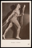 view George O'Brien posing holding a bow and arrows. Photographic postcard, 192-.