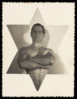 view A wrestler inset centrally in a six-pointed star. Photographic postcard, 19--.