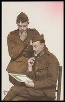view Two Belgian soldiers contemplating documents. Colour photographic postcard, 192-.