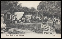view People relaxing at a summer camp on the Thames. Process print, ca. 1911.