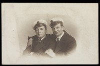 view Two British naval officers in an intimate pose, one with his arms round the other. Photographic postcard, 192-.