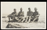 view World War II: engineers of the GHQ Middle East Forces (?) relaxing on the coast of Egypt (?). Photographic postcard, 194-.