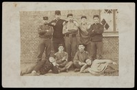 view Belgian soldiers posing for a group portrait in a casual manner. Photographic postcard, 1908.