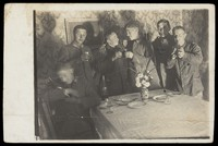 view German soldiers enjoying a drink in a dining room. Photographic postcard, 190-.