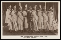 """view Actors dressed as a clowns, performing for """"The Timbertown Follies"""", at a prisoner of war camp in Groningen. Photographic postcard, 191-."""
