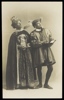 view Actors in pantomime in Brighton: S. West playing King Robert of Remlaf and H. Taylor in drag as Queen Aggie of Remlaf. Photographic postcard.