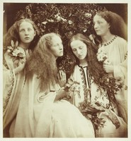 view Four young women holding flowers. Photograph by J.M. Cameron, 1868.