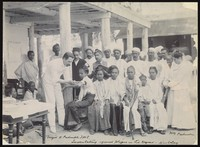 view A group of people being inoculated against the plague in a bazaar in Mandalay. Photograph, c. 1906.