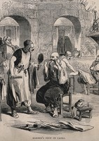 view A barber's shop in Cairo; a barber holds a mirror for a man while he adjusts his moustache. Wood engraving.