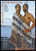 view Two young Māori men standing with face decoration and a feather wrap against the backdrop of the sea representing an advertisement for AIDS helplines for Māori gay/bisexual men; advertisement by Te Waka Āwhina Takataapui Tane. Colour lithograph by Albert Sword.