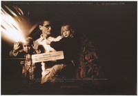 view An HIV positive family man holding two children beside figures cut out of meat, bearing the warning 'Sondermüll-Mensch' (human hazardous waste); advertising an exhibition about the Upper Austrian AIDS-Hilfe. Colour lithograph by Mares Andreas, 1995.