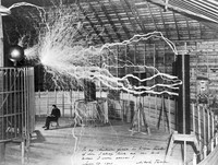 view Nikola Tesla, with his equipment for producing high-frequency alternating currents.